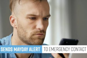 Man looking at phone after receiving mayday alert from dash camera